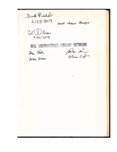 "Signed page of the book ""Oscillations and Travelling Waves in Chemical Systems"" (1985)"